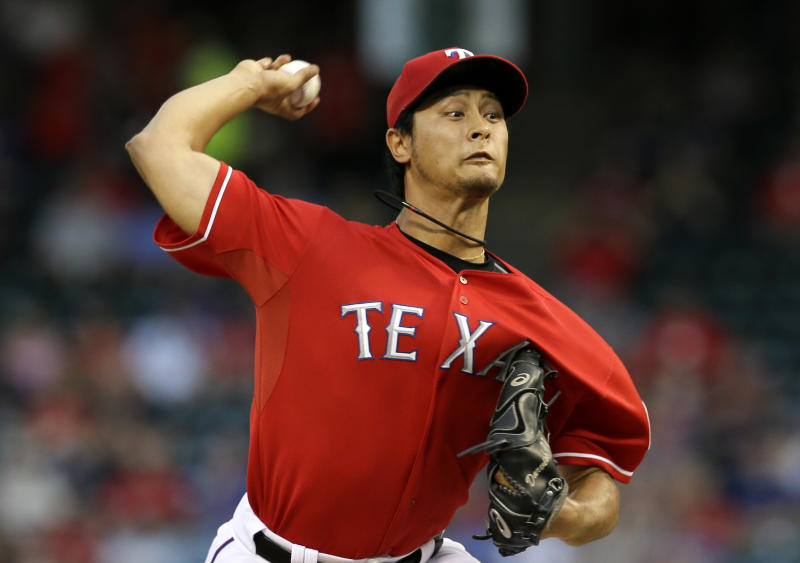 Texas Rangers starting pitcher Yu Darvish (11), of Japan, works against the Pittsburgh Pirates in the first inning of a baseball game, Monday, Sept. 9, 2013, in Arlington, Texas. (AP Photo/Tony Gutierrez)