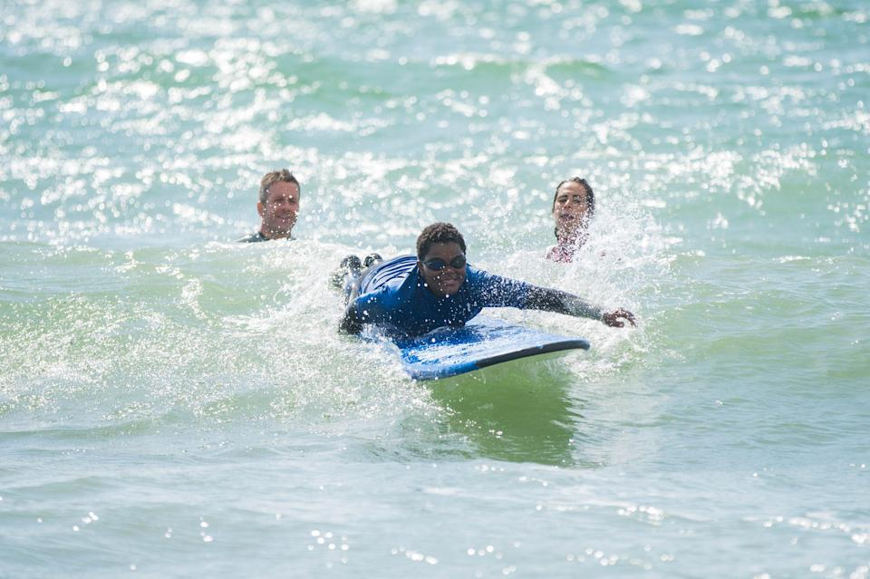 <p>Freedom: Casey, 12, enjoys some surf with the City to Sea Wave Project, which gives London children lessons to help improve their wellbeing</p> (Handout)