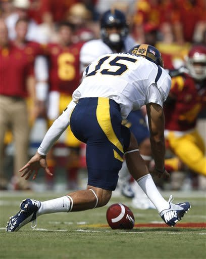 California quarterback Zach Maynard fumbles during the first half of an NCAA college football game against Southern California in Los Angeles, Saturday, Sept. 22, 2012. (AP Photo/Jae C. Hong)