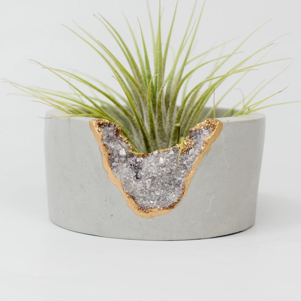 """<p>The design of this <a href=""""https://www.popsugar.com/buy/Tal-Bert-Lepidolite-Mini-Planter-581174?p_name=Tal%20and%20Bert%20Lepidolite%20Mini%20Planter&retailer=talandbert.com&pid=581174&price=30&evar1=casa%3Aus&evar9=45784601&evar98=https%3A%2F%2Fwww.popsugar.com%2Fhome%2Fphoto-gallery%2F45784601%2Fimage%2F47575649%2FTal-Bert-Lepidolite-Mini-Planter&list1=shopping%2Cproducts%20under%20%2450%2Cdecor%20inspiration%2Caffordable%20shopping%2Chome%20shopping&prop13=api&pdata=1"""" class=""""link rapid-noclick-resp"""" rel=""""nofollow noopener"""" target=""""_blank"""" data-ylk=""""slk:Tal and Bert Lepidolite Mini Planter"""">Tal and Bert Lepidolite Mini Planter</a> ($30) is so beautiful.</p>"""