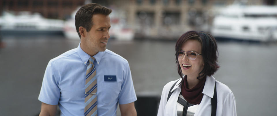 """This image released by 20th Century Studios shows Jodie Comer, right, and Ryan Reynolds in a scene from """"Free Guy."""" (20th Century Studios via AP)"""