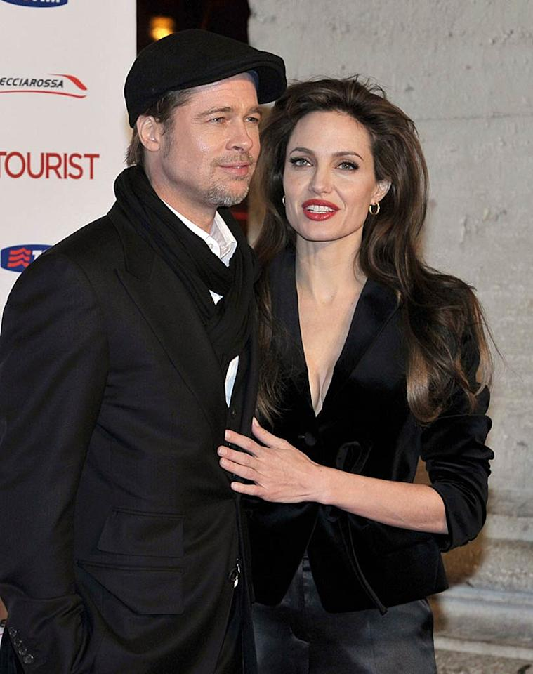 "<i>OK!</i> reports exclusively that Angelina Jolie and Brad Pitt ""finally made a lifelong commitment – and are secretly married."" Jolie is even wearing her wedding band, but on her right hand. ""A secret wedding is entirely in character"" for Brangelina, notes <i>OK!</i>, since ""the unconventional couple is notoriously coy about major life events."" For details about where and when they ""secretly tied the knot,"" get the full story from <a href=""http://www.gossipcop.com/angelina-jolie-brad-pitt-secretly-married/"" target=""new"">Gossip Cop</a>. Kika Press/<a href=""http://www.pacificcoastnews.com/"" target=""new"">PacificCoastNews.com</a> - December 16, 2010"