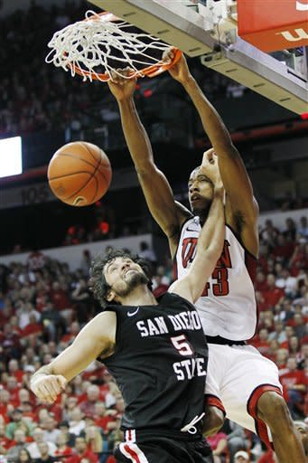 UNLV's Mike Moser, right, dunks over San Diego State's Garrett Green (5) during the second half of an NCAA college basketball game, Saturday, Feb. 11, 2012, in Las Vegas. (AP Photo/Isaac Brekken)