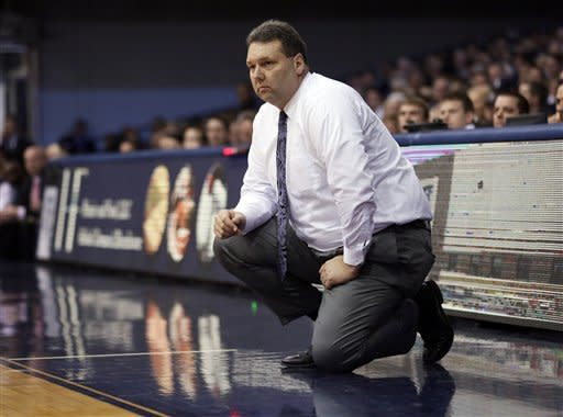Evansville coach Marty Simmons watches as his team plays Butler in the first half of an NCAA college basketball game, Saturday, Dec. 22, 2012, in Indianapolis. Butler won 75-67. (AP Photo/AJ Mast)