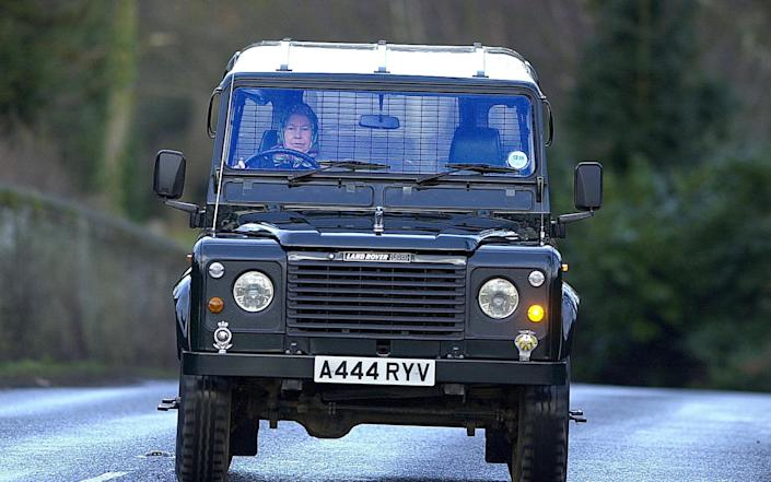 The Queen driving her Land Rover – she was trained to fix trucks during the war - PA