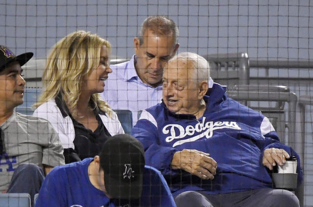 Los Angeles Lakers president Jeanie Buss, left, talks with former Los Angeles Dodgers manager Tommy Lasorda during the fourth inning of a baseball game between the Dodgers and the San Francisco Giants on Wednesday, Aug. 15, 2018, in Los Angeles. (AP Photo/Mark J. Terrill)