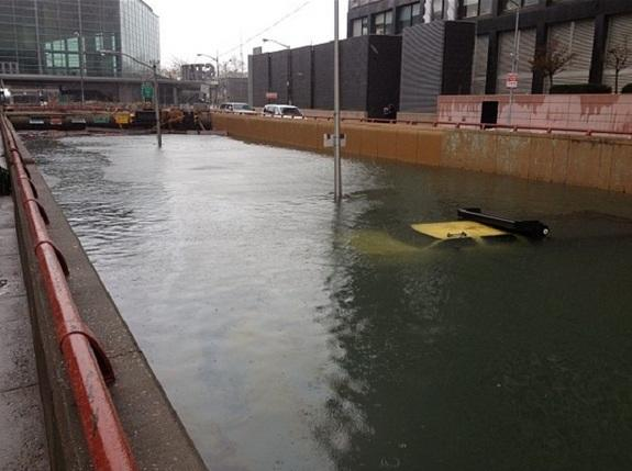 Entrance to Battery Park flooded, NYC DOT truck seen submerged, blocking entrance after early closure on Oct. 29.