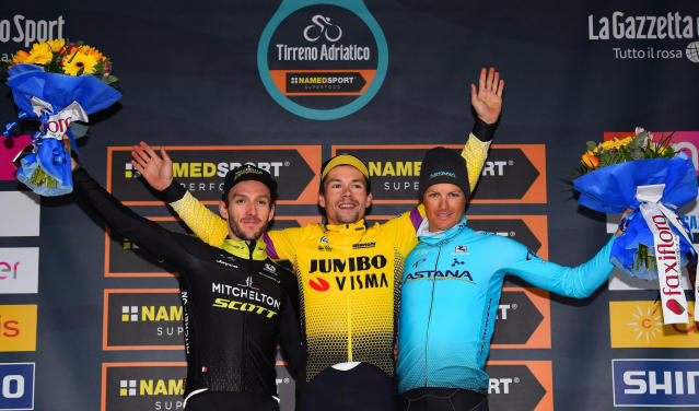 Slovenia's Primoz Roglic, winner of the 54th Tirreno Adriatico cycling race, center, celebrates on the podium with second-placed Britain's Adam Yates, left, and third-placed Denmark's Jakob Fuglsang, in San Benedetto del Tronto, central Italy, Tuesday, March 19, 2019. (Dario Belinghieri/ANSA via AP)
