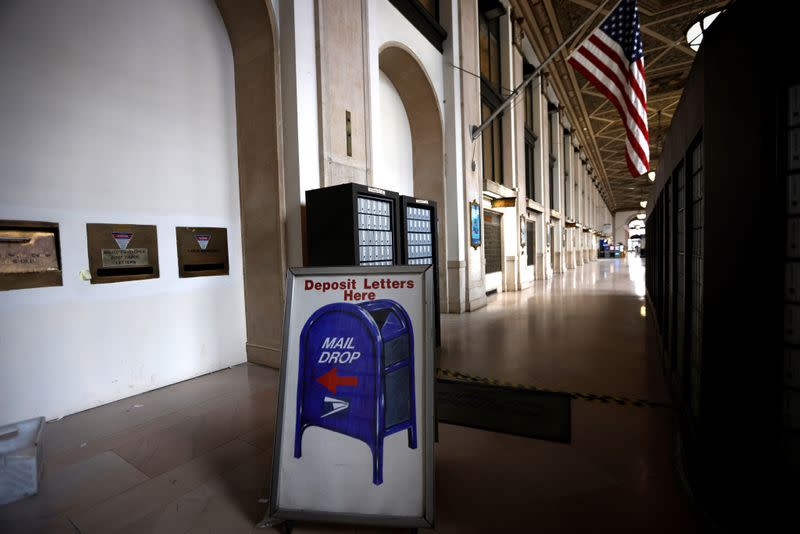 Sign is seen inside the James A. Farley U.S. Postal Service (USPS) office in midtown Manhattan in New York