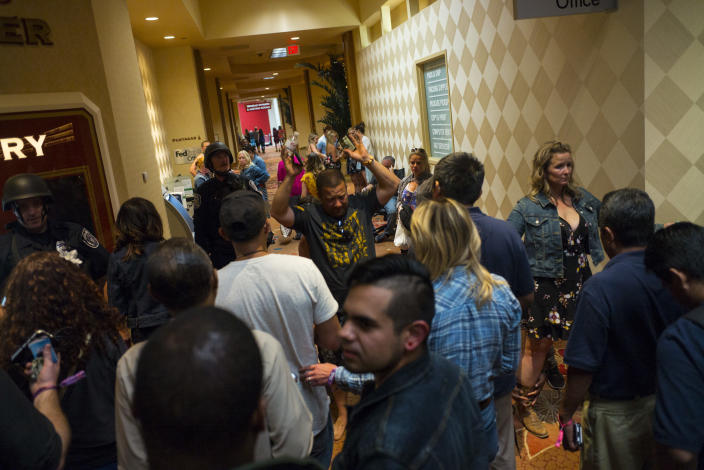 <p>People are searched by Las Vegas police at the Tropicana Las Vegas during an active shooter situation on the Las Vegas Strip on Sunday, Oct. 1, 2017. (Photo: Chase Stevens/Las Vegas Review-Journal via AP) </p>
