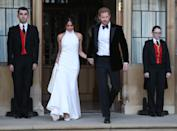 <p>Meghan and Harry make their way to their evening reception on their wedding day. The bride wore a second dress by Stella McCartney (Getty) </p>