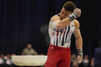 Brody Malone blows chalk off his arm during the men's U.S. Olympic Gymnastics Trials Saturday, June 26, 2021, in St. Louis. (AP Photo/Jeff Roberson)