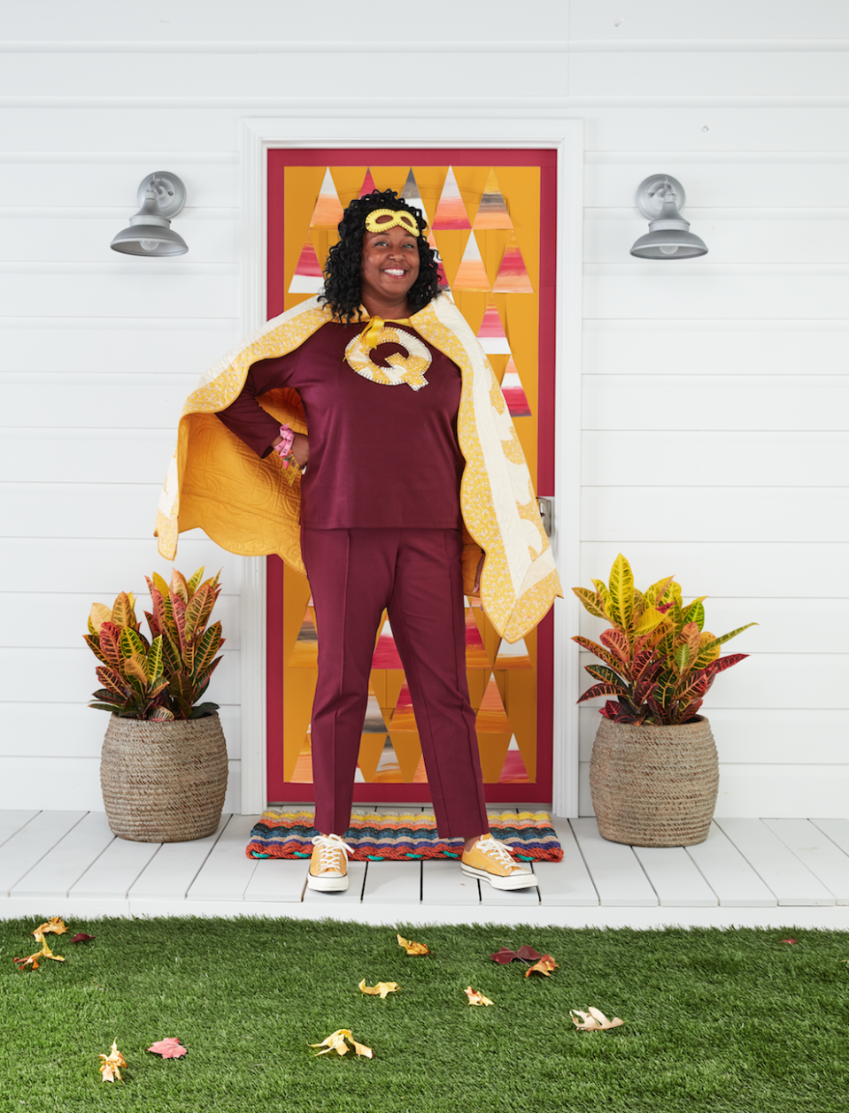"""<p>When you're a mom, you're already a superhero. However, if you love quilting, become the super quilter for Halloween!</p><p><strong>Make the Costume: </strong>Cut a quilt into a trapezoid shape; sew a corresponding color bias tape around the edges to finish. At the top corner of the trapezoid, sew a corresponding color ribbon for ties. Use a scrap of the quilt to cut out an oversize letter """"Q"""" and blanket stitch it to the front of a T-shirt. Blanket stitch around the edges of a felt superhero mask and round out the look with a tailor tape measure bracelet adorned with sewing charms. Glue a metal thimble to a silver ring blank to create a superpower ring.</p><p><a class=""""link rapid-noclick-resp"""" href=""""https://www.amazon.com/flic-flac-inches-Assorted-Fabric-Patchwork/dp/B01GCRXBVE/?tag=syn-yahoo-20&ascsubtag=%5Bartid%7C10050.g.28181767%5Bsrc%7Cyahoo-us"""" rel=""""nofollow noopener"""" target=""""_blank"""" data-ylk=""""slk:SHOP FELT"""">SHOP FELT</a></p>"""