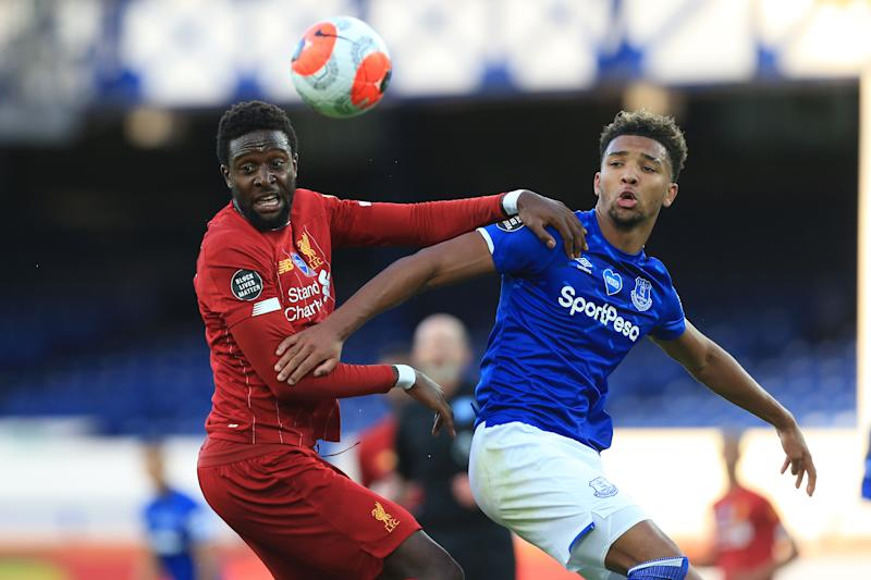 Neither Liverpool's Divock Origi nor Everton's Mason Holgate could find a goal in the Merseyside derby, to say nothing of both sides entirely. (Photo by Simon Stacpoole/Offside/Offside via Getty Images)