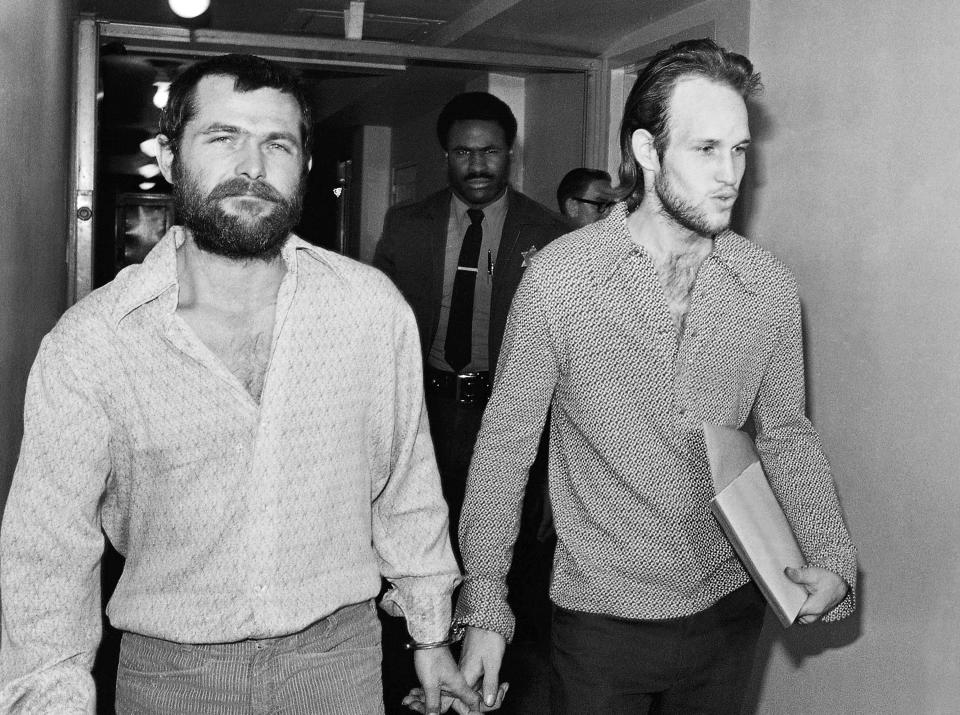 FILE - This Dec. 22, 1970 file photo shows Charles Manson family members, Bruce Davis, left, and Steve Grogan, leaving court after a hearing in Los Angeles. Fifty years ago Charles Manson dispatched a group of disaffected young hippie followers on a two-night killing spree that terrorized Los Angeles and in the years since has come to represent the face of evil. On successive nights in August 1969, the so-called Manson family murdered seven people. (AP Photo/Harold Filan, File)