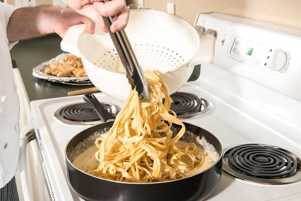 """<p>There are many pasta dishes that make <a href=""""https://www.thedailymeal.com/cook/americas-25-favorite-home-cooked-dishes?referrer=yahoo&category=beauty_food&include_utm=1&utm_medium=referral&utm_source=yahoo&utm_campaign=feed"""" rel=""""nofollow noopener"""" target=""""_blank"""" data-ylk=""""slk:perfect home-cooked meals"""" class=""""link rapid-noclick-resp"""">perfect home-cooked meals</a>, but only if you follow the next couple steps. Drain your pasta when it is still a minute or two away from al dente perfection and let it finish cooking in the sauce. Doing this will allow the pasta to absorb some of the sauce and the end result will be tastier and more full of flavor than if you just dump sauce over some plain pasta.</p>"""