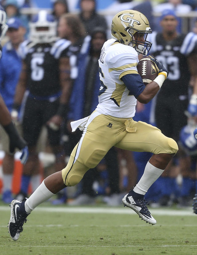FILE - In this Sept. 26, 2015, file photo, Georgia Tech's TaQuon Marshall carries the football during the first half of an NCAA college football game, in Durham, N.C. Virginia's last exposure to a running attack like the one Georgia Tech employs could hardly have gone worse. After taking an early 7-0 lead against Navy in last years Military Bowl, the Cavaliers gave up 49 unanswered points in a 49-7 defeat. They will try again to shut down the triple option when they play the Yellow Jackets on Saturday, Nov. 17. (AP Photo/Rob Brown, File)