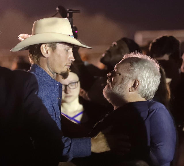<p>Stephen Willeford, right, hugs Johnnie Langendorff during a vigil for the victims of the First Baptist Church shooting Monday, Nov. 6, 2017, in Sutherland Springs, Texas. Willeford shot suspect Devin Patrick Kelley and Langendorff drove the truck while they chased Kelley. Kelley opened fire inside the church in the small South Texas community on Sunday, killing more than two dozen and injuring others. (Photo: David J. Phillip/AP) </p>