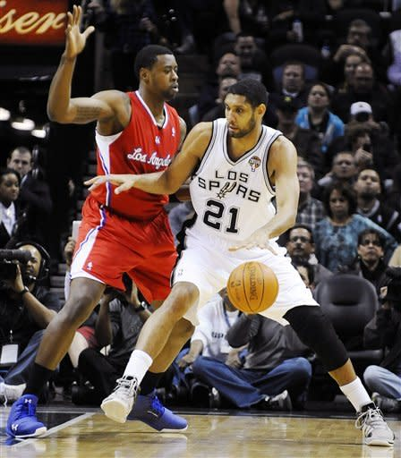 Los Angeles Clippers' DeAndre Jordan defends San Antonio Spurs' Tim Duncan (21) during the first half of an NBA basketball game, Friday, March 9, 2012, in San Antonio. (AP Photo/Darren Abate)