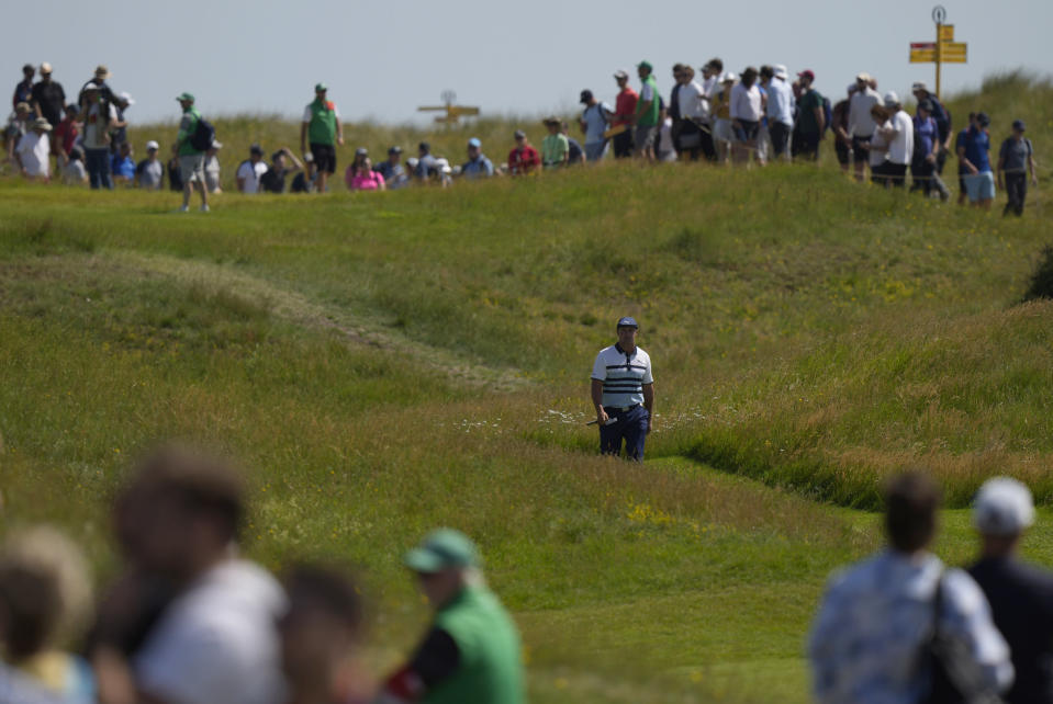 United States' Bryson DeChambeau makes this way along the 8th fairway to the green during the third round of the British Open Golf Championship at Royal St George's golf course Sandwich, England, Saturday, July 17, 2021. (AP Photo/Alastair Grant)