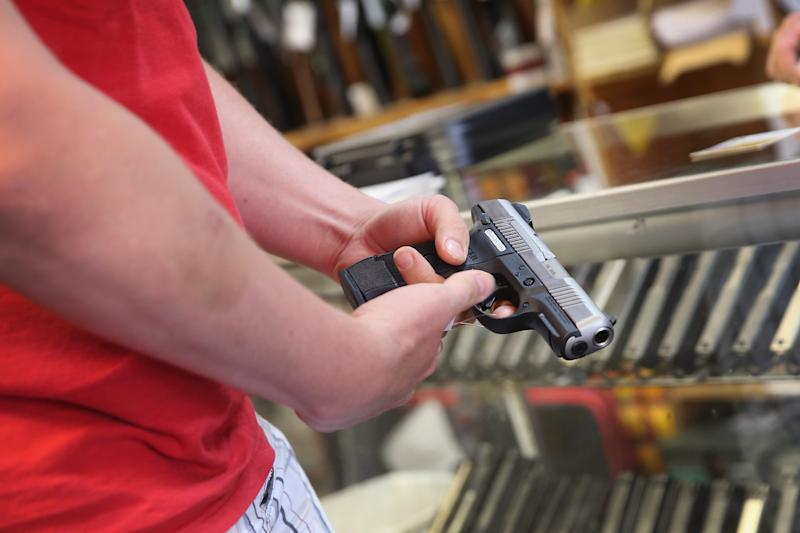 A customer shops for a handgun on June 16, 2014 in Tinley Park, Illinois