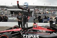 Robert Wickens stands on his car after winning the pole for the IndyCar auto race, Saturday, March 10, 2018, in St. Petersburg, Fla. (Luis Santana/Tampa Bay Times via AP)