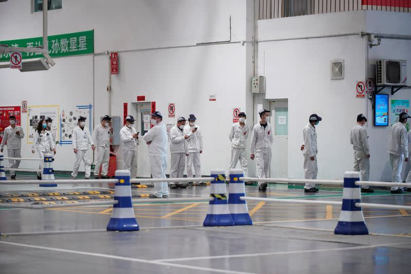 Employees line up inside a Dongfeng Honda factory in Wuhan