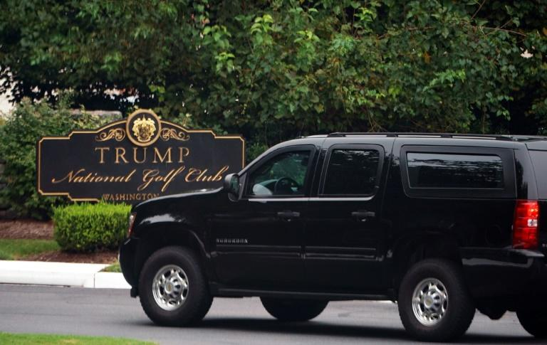 A motorcade carrying US President Donald Trump enters the Trump National Golf Club in Sterling, Virginia