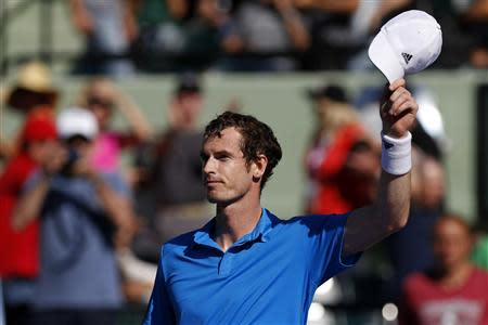 Mar 25, 2014; Miami, FL, USA; Andy Murray waves to the crowd after his match against Jo-Wilfried Tsonga (not pictured) on day nine of the Sony Open at Crandon Tennis Center. Geoff Burke-USA TODAY Sports