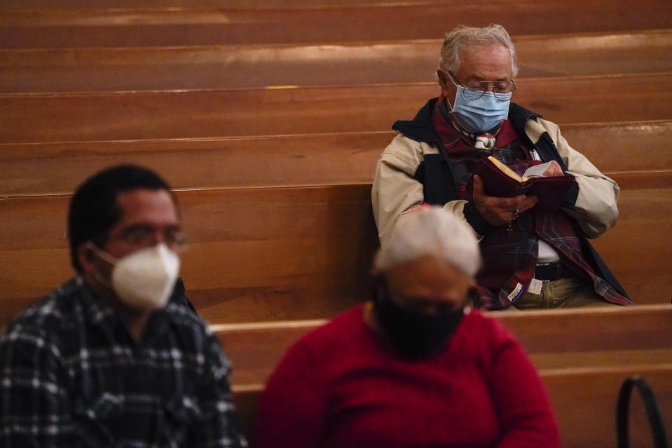 Worshipers gather for a Christmas Eve Mass inside the Cathedral of Our Lady of the Angels, Thursday, Dec 24, 2020, in Los Angeles. California became the first state to record 2 million confirmed coronavirus cases, reaching the milestone on Christmas Eve as nearly the entire state was under a strict stay-at-home order and hospitals were flooded with the largest crush of cases since the pandemic began. (AP Photo/Ashley Landis)