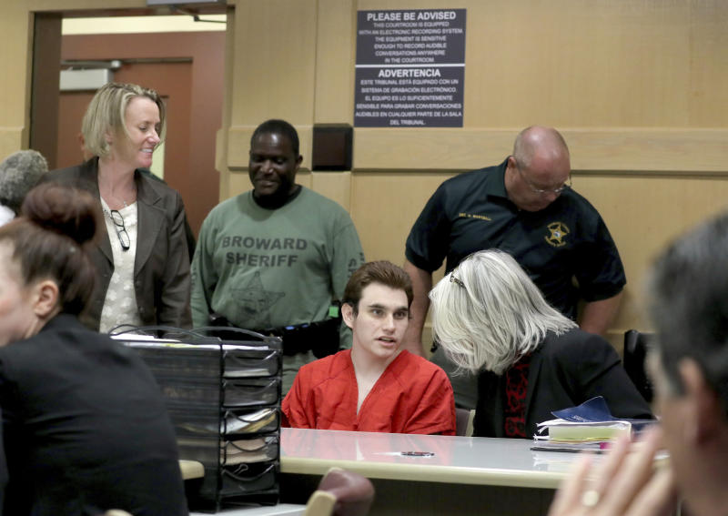 Parkland school shooting suspect Nikolas Cruz speaks with his attorney in court for a defense motion at the Broward Courthouse in Fort Lauderdale, Fla., Thursday, April 18, 2019. Cruz is accused of killing 17 and wounding 17 in the February 2018 mass shooting at Marjory Stoneman Douglas High School in Parkland, Fla. (Mike Stocker/South Florida Sun-Sentinel via AP, Pool)