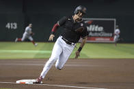 Arizona Diamondbacks Pavin Smith rounds third on the way to scoring against the Washington Nationals during the first inning during a baseball game Saturday, May 15, 2021, in Phoenix. (AP Photo/Rick Scuteri)