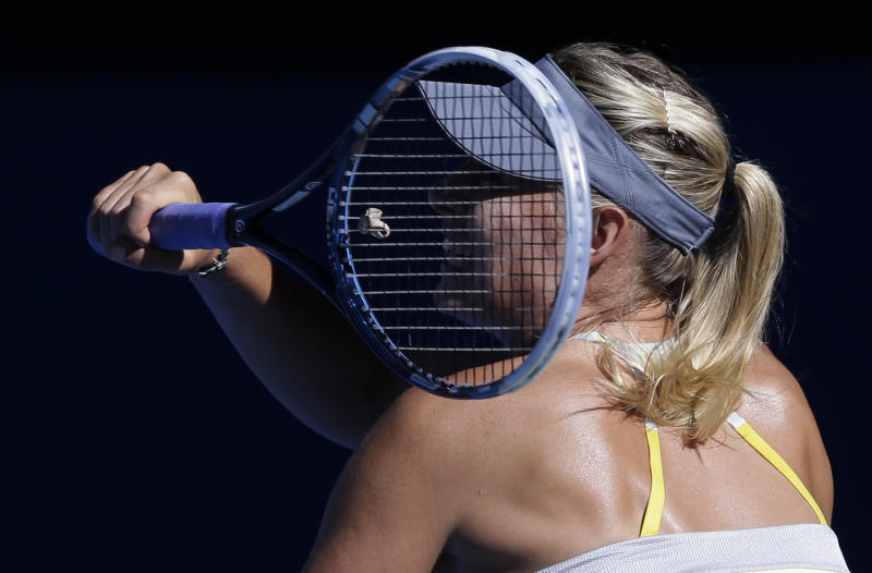 Russia's Maria Sharapova hits a forehand return to compatriot Ekaterina Makarova during their quarterfinal match at the Australian Open tennis championship in Melbourne, Australia, Tuesday, Jan. 22, 2013. (AP Photo/Andy Wong)