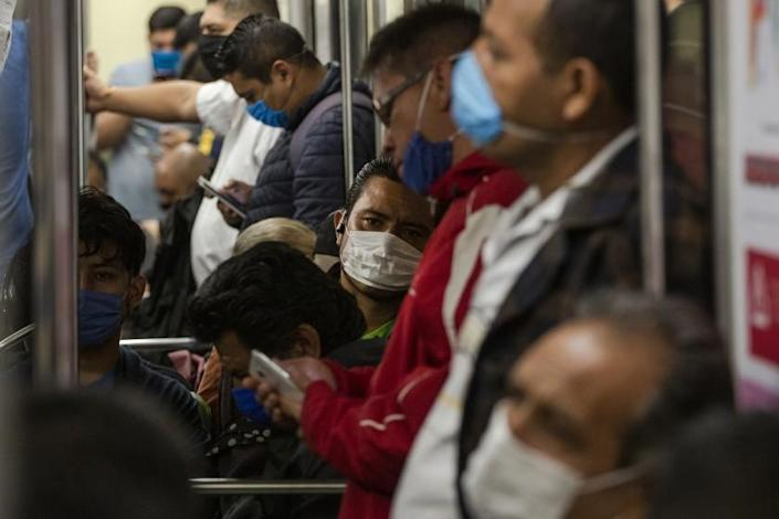 """People ride the subway on April 17, 2020, in Mexico City. <span class=""""copyright"""">(Cristopher Rogel Blanquet / Getty Images)</span>"""