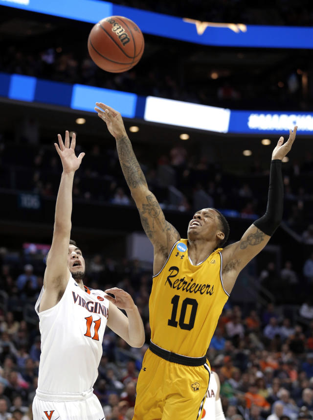 Virginia's Ty Jerome (11) shoots over UMBC's Jairus Lyles (10) during the first half of a first-round game in the NCAA men's college basketball tournament in Charlotte, N.C., Friday, March 16, 2018. (AP Photo/Bob Leverone)