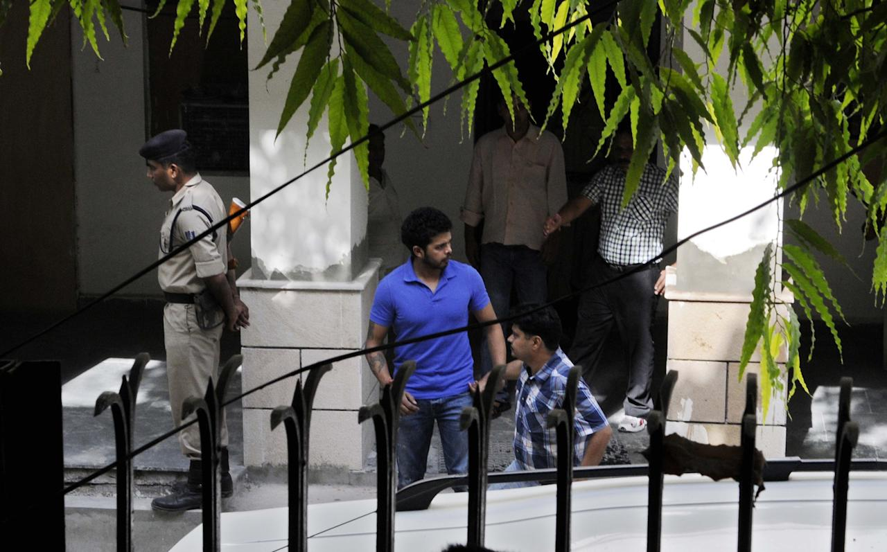 NEW DELHI, INDIA - MAY 21: Indian Cricketer Sreesanth along with the Special Cell Officials at the Special Cell Office at Lodhi Colony on May 21, 2013 in New Delhi, India. Sreesanth was remanded in further five-day police custody by Metropolitan Magistrate. (Photo by Sushil Kumar/Hindustan Times via Getty Images)