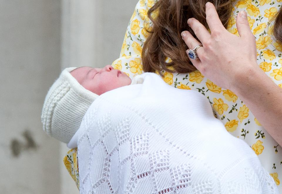 <p>Princess Charlotte of Cambridge being held by her mother outside the Lindo Wing. (Zak Hussein/Corbis)</p>