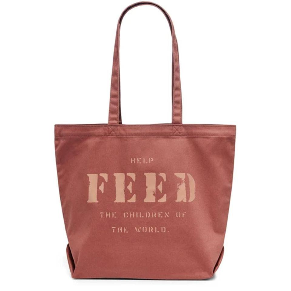 """<p>feedprojects.com</p><p><strong>$28.00</strong></p><p><a href=""""https://feedprojects.com/collections/holiday-2020/products/feed-10-bag?variant=32150405808195"""" rel=""""nofollow noopener"""" target=""""_blank"""" data-ylk=""""slk:Shop Now"""" class=""""link rapid-noclick-resp"""">Shop Now</a></p><p>Feed's iconic canvas bags are associated with one thing: providing meals for hungry children. With several fun color variations available and enough room to store everything during grocery store runs or errands, this bag makes it easy to wear again and again. The <a href=""""https://feedprojects.com/pages/our-giving"""" rel=""""nofollow noopener"""" target=""""_blank"""" data-ylk=""""slk:proceeds from each sale"""" class=""""link rapid-noclick-resp"""">proceeds from each sale</a> will raise enough money to provide 10 school meals. </p>"""