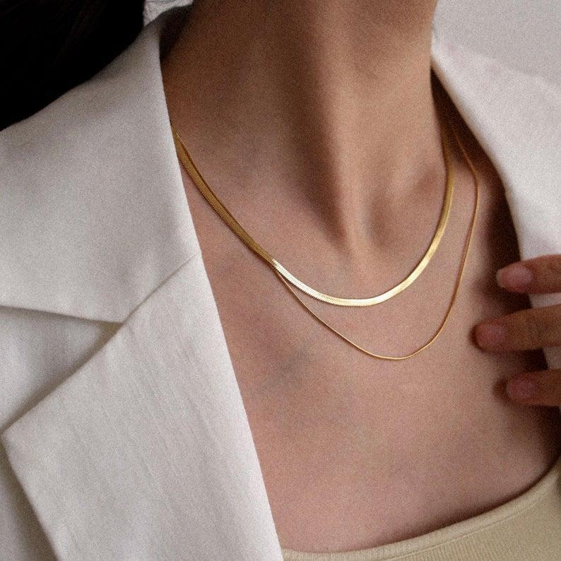 <p>Everyone needs to have a <span>Shapes Studio Gold Double Herringbone Chain Necklace</span> ($45) in their jewelry assortment. It's so chic and refined, you'll wear it with everything.</p>