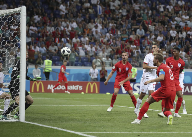 England's Harry Kane scores during the group G match between Tunisia and England at the 2018 soccer World Cup in the Volgograd Arena in Volgograd, Russia, Monday, June 18, 2018. (AP Photo/Thanassis Stavrakis)