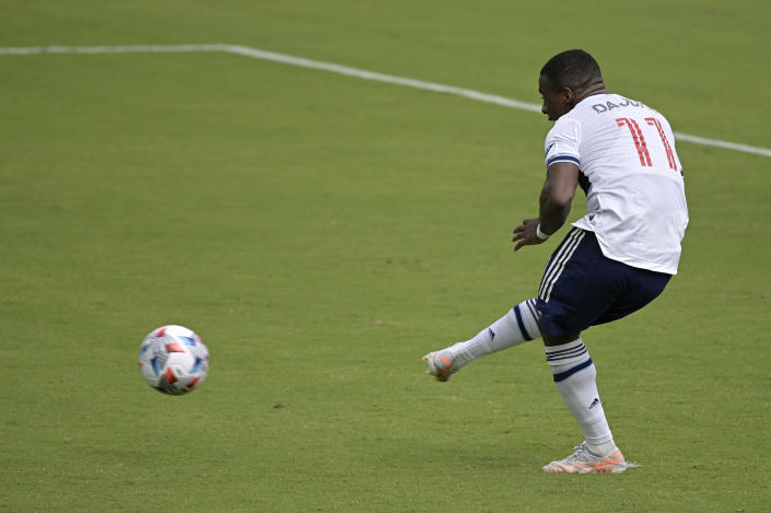 Vancouver Whitecaps forward Cristian Dajome (11) scores on a penalty kick during the second half of an MLS soccer match against Toronto FC, Saturday, April 24, 2021, in Orlando, Fla. (AP Photo/Phelan M. Ebenhack)