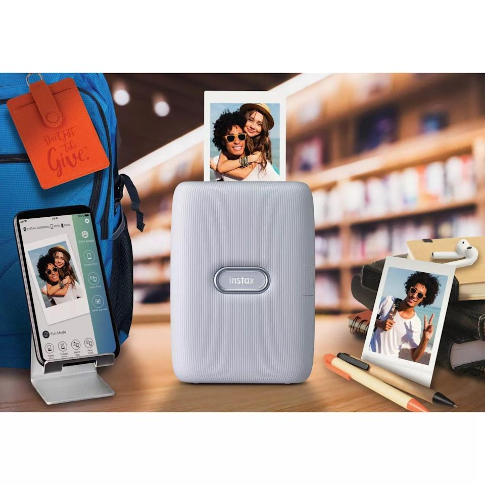 <p>The <span>Fujifilm Instax Mini Link Smartphone Printer</span> ($100) let's them print out their favorite memories right from their phone. (Read: they don't need to have big bulky printer in their house!)</p>