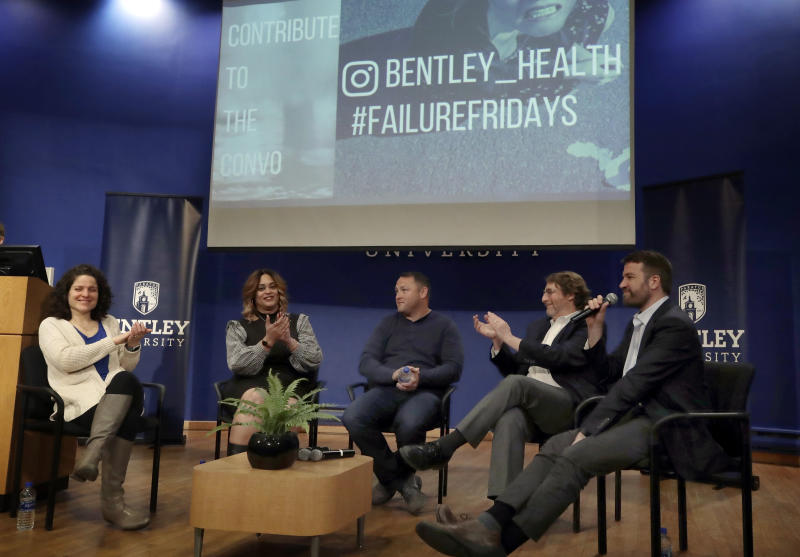 "In this March 5, 2019 photo, panel members, from left, Angela Giordano, Natalie Baucum, Mike Duggan, Fred Ledley and school counselor Peter Forkner participate in an event at Bentley University, in Waltham, Mass., where professors and alumni shared some of their worst setbacks to illustrate that even successful people sometimes fail. A growing number of U.S. colleges are trying to ""normalize"" failure for a generation of students who increasingly struggle with stress, anxiety and the ability to bounce back from adversity. (AP Photo/Elise Amendola)"