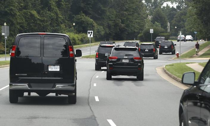 "<span class=""element-image__caption"">Trump's motorcade drives to Trump National Golf Club in Sterling, Virginia, on Saturday.</span> <span class=""element-image__credit"">Photograph: Patrick Semansky/AP</span>"