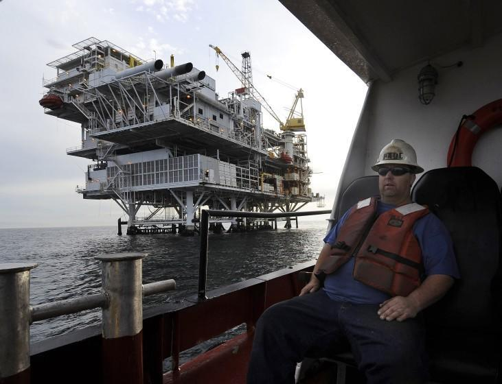 """FILE - In this May 1, 2009 file photo, a crew member arrives by boat at th offshore oil drilling platform """"Gail"""", operated by Venoco, Inc., off the coast near Santa Barbara, Calif. Leaders in the California Senate say they are introducing legislation to thwart President Donald Trump's attempts to expand offshore drilling through an executive order he signed Friday, April 28, 2017. (AP Photo/Chris Carlson, File)"""