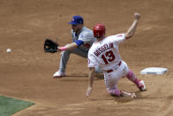 Los Angeles Dodgers second baseman Gavin Lux, left, waits for the throw before tagging out Los Angeles Angels' Phil Gosselin on a steal attempt during the third inning of a baseball game in Anaheim, Calif., Sunday, May 9, 2021. (AP Photo/Alex Gallardo)