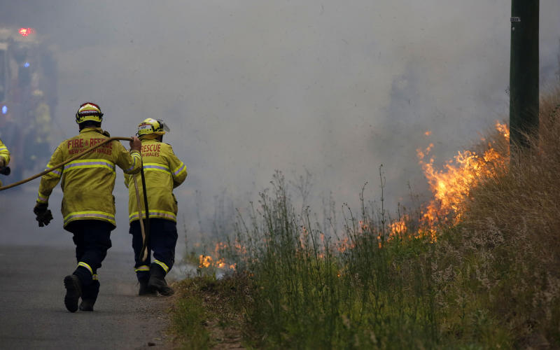 Firefighters work on a controlled burn in Koorainghat, south of Taree.