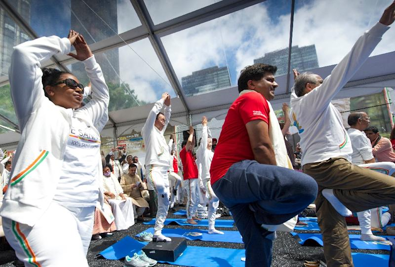 UN Secretary General Ban Ki-moon(C) takes part in a special event celebrating the first International Day of Yoga on June 21, 2015 at UN headquarters in New York (AFP Photo/Mark Garten)