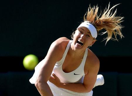FILE PHOTO: Maria Sharapova of Russia serves during her match against Serena Williams of the U.S.A. at the Wimbledon Tennis Championships in London, July 9, 2015.    REUTERS/Toby Melville/File Photo