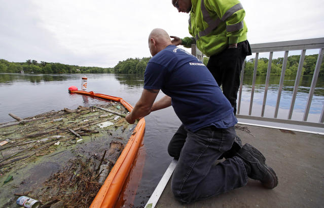 "<p>Activist Rocky Morrison, left, of the ""Clean River Project"" examines a boom filled with waste collected from a recovery boat on the Merrimack River in Chelmsford, Mass. Morrison leads a cleanup effort along the Merrimack River, which winds through the old milling city of Lowell, and has recovered hundreds of needles in abandoned homeless camps that dot the banks, as well as in piles of debris that collect in floating booms he recently started setting. (Photo: Charles Krupa/AP) </p>"